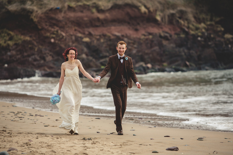 Wedding beach photos at Manorbier Castle by Whole Picture Weddings