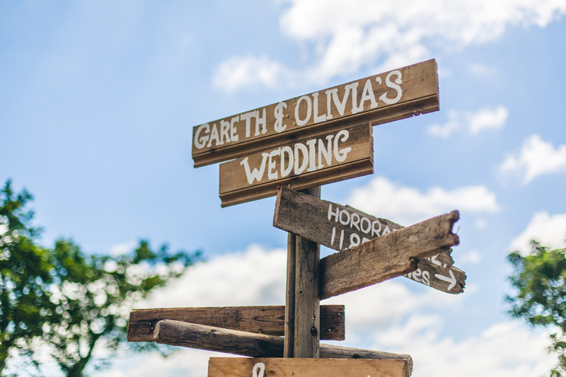 Homemade wedding signposts. At home Pembrokeshire wedding by Whole Picture Weddings