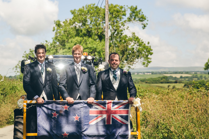 Groom arrives in a cherry-picker! At home Pembrokeshire wedding by Whole Picture Weddings