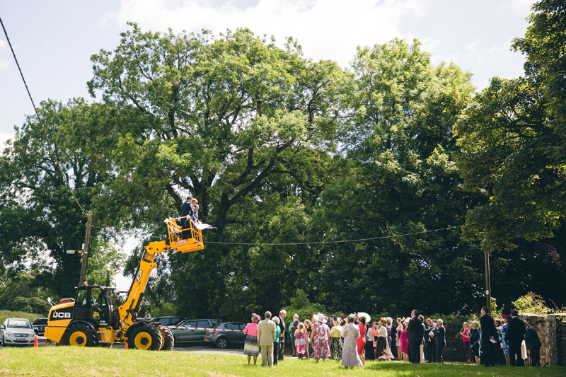 Groom arrives in a cheery-picker! At home Pembrokeshire wedding by Whole Picture Weddings