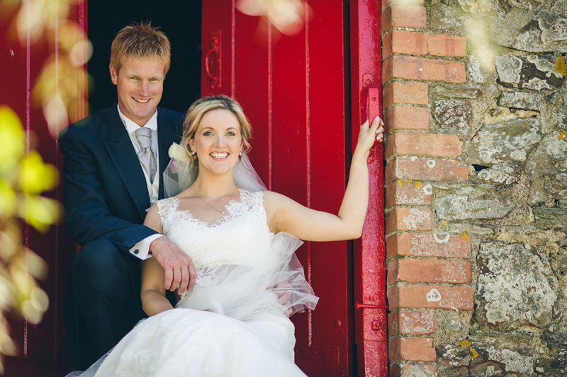 Gorgeous red barn doors. At home Pembrokeshire wedding by Whole Picture Weddings