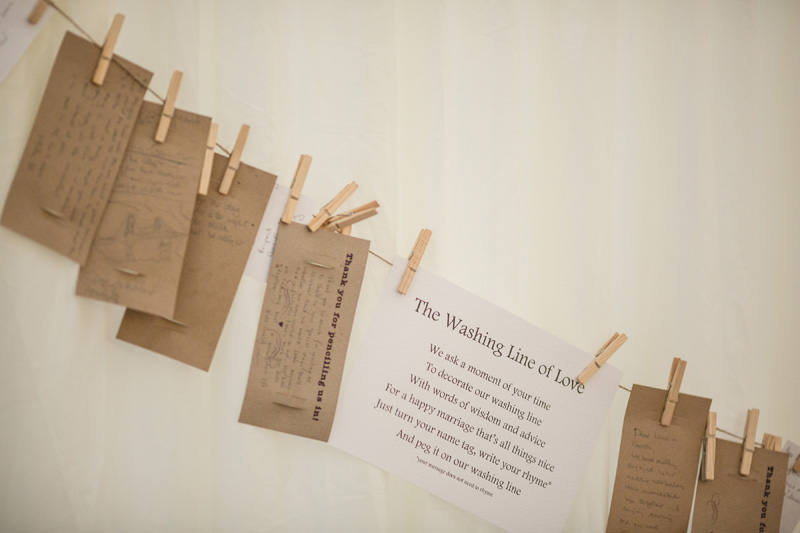 Washing line guest book. At home Pembrokeshire wedding by Whole Picture Weddings
