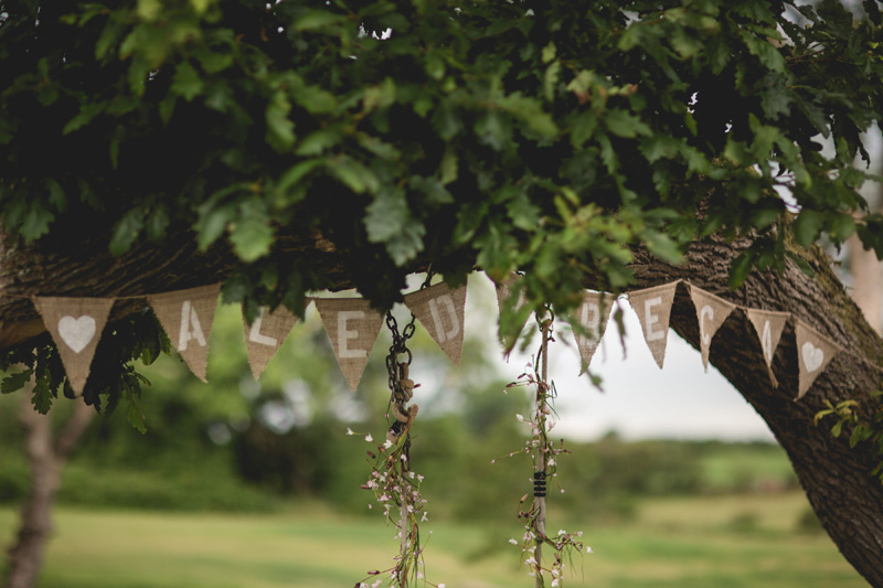 Names bunting | Rainy summer wedding at Oldwalls, Gower by Whole Picture Wedding Photography
